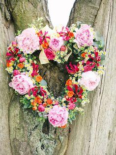 A gorgeous peony heart shaped wreath