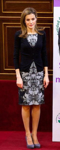 This is the ninth occasion Letizia has worn the ink-blot sheath dress since its debut in October 2013, but the first time she has worn it without a blazer or cardigan. February 2014.