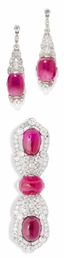 An art deco ruby, tourmaline and diamond brooch and earring suite, by Van Cleef & Arpels, circa 1930 The brooch set to the centre with a sugarloaf ruby, between elongated scalloped terminals, set with a large cabochon ruby, a large oval cabochon tourmaline and old brilliant and single-cut diamonds in millegrain and collet settings, the pendent earrings of similar design, mounted in platinum, brooch signed Van Cleef & Arpels Paris,