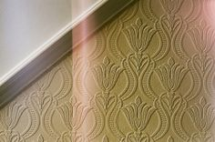 paintable wallpaper - love this idea!  For under chair rail?  Also, this is the exact pattern on our gray and white rug!