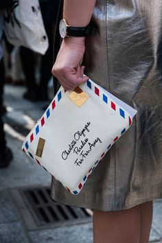 Details in street style. Charlotte Olympia clutch at Paris Fashion Week Spring 2015. #pfw #charlotteolympia