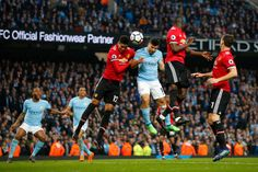 Sergio Aguero of Manchester City wins a header during the Premier League match between Manchester City and Manchester United at Etihad Stadium on. Manchester United Football, Manchester City, Premier League Matches, Header, The Unit, Sports, Club, Hs Sports, Manchester United Soccer