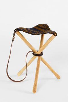 Unique wooden stool with a woolen seat in one of Pendleton's signature prints. Packs right up so you can carry it just about anywhere. #urbanoutfitters