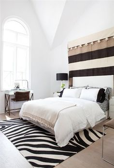 A very simple bedroom is given major style and depth with these simple, African-inspired touches. The art on the wall draws on the rich colours of the savannah.