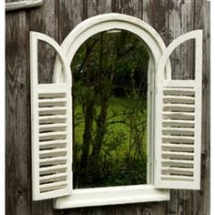 Rustic and distressed, vintage style wood framed mirror with french shutters adds a great touch to your garden shed! Available at Land & Garden. $89