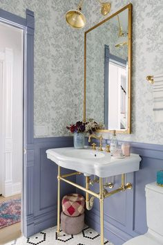 Whether you want to go with bright colors, add subtle gold accents, or incorporate bold wallpaper, I've pulled together stylish bathrooms to get you inspired. No boring bathrooms allowed! Wainscoting is back, and in fun colors! Open plumbing sinks add to brass accents throughout the bathroom. Fun wallpaper is an easy and unique way to add bold character! Colorful Bathroom Designs to Inspire Your Remodel | Charleston Blonde #bathroomdesign #interiordesign #colorfulliving #designincolor…