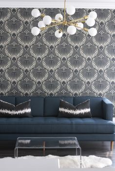 Graphic, art deco inspired wall paper and a statement making chandelier--repin via Owens and Davis