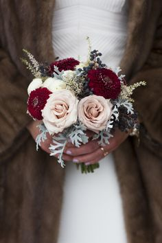 Winter bridal posy with Quicksand roses, viburnum berries, astilbe, Black Pearl gerberas and dusty miller foliage for an intimate wedding at @anestatehotel Bouquet created by Calgary Wedding Florist- Flowers by Janie www.flowersbyjanie.com Photo: www.studiolumen.ca
