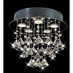 @Overstock - This crystal ceiling chandelier would be an elegant addition to your home. Featuring crystals raining down from a glossy chrome base, the 14-inch height makes it perfect for adding a brilliant lighting effect to homes that have low ceilings.http://www.overstock.com/Home-Garden/Round-Chorus-5-light-Chrome-Ceiling-Chandelier/6543531/product.html?CID=214117 $129.99