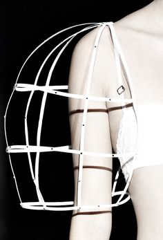 Sleeve Cage - sculptural fashion with a hollow 3D cage construct; structured fashion design detail