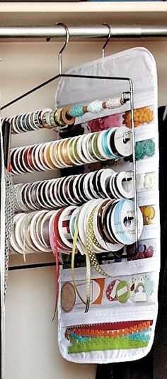 Use a pants hanger to store ribbon in a guests bedroom closet. I would tie a spare pair of scissors to it.
