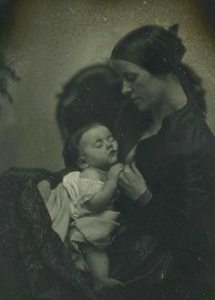 Madonna and child...1845. This is almost a nursing-photo and I believe that the lighting was purposely dimmed. In my first daguerreotype board there are two nursing-photos. They were not considered improper, nor immodest.