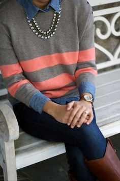 Striped sweater layered over chambray shirt with a jeweled necklace