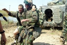 US Marines help a wounded comrade in Iraq in March 2003. American combat troops will leave Iraq by year's end, but the war will not end.