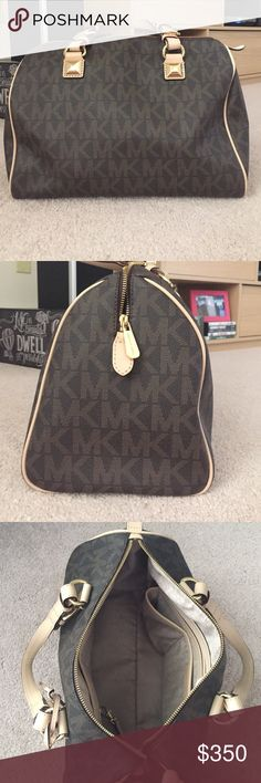 Michael Kors bag Michael Kors bag. Uses probably less than five times. Bag has 2 handles and no shoulder strap. Bag is about 14 inches across, 8 1/2 inches tall, and 7 1/2 inches wide. Only imperfection is a very small mark on the trim of the bag. Shown in additional pictures. Michael Kors Bags