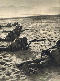 Troops of the Japanese 18th Infantry Regiment at the west bank of the Han River, Battle of Zaoyang-Yichang, China, 31 May 1940