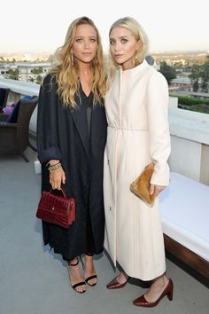 Mary-Kate Olsen and Ashley Olsen, both in The Row.