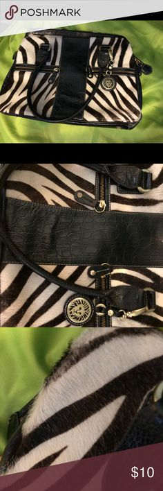 Zebra fur print purse 👜 Zebra fur print purse 👜 opened up to 3 desperate compartments great used condition please notice the little bit of wear on corner. Bags Satchels
