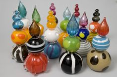 """Beacons, by Bee Kingdom. Blown glass. Multi-part sculptures exhibiting form and colour. These glass pieces stand about 12"""" tall."""