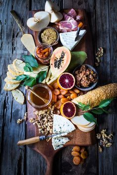 A Winter Cheese Board with Blood Orange Marmalade and Castello cheeses, winter fruits, nuts and honey...a match made in heaven. | http://www.Feastingathome.com