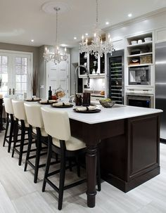 Dark wood + light wall color and counter tops = CLASSY.  More importantly - it leaves room for you to put your legs.