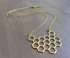 Geometric Honeycomb Necklace, Hexagon Gold Necklace, Statement Jewelry, Geometric Jewelry, Cool Necklace, Friendship Necklace, Gift Under 25 by funnybunnyjewelry on Etsy https://www.etsy.com/listing/216230440/geometric-honeycomb-necklace-hexagon