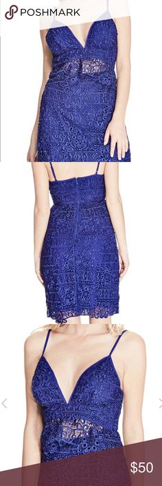 Royal Blue Guess Lace dress The cutout design at the front of this lace dress shows a little skin through the ruffled top layer, delivering an edge-driven appeal. Attached slip, adjustable straps and back zipper closure. Guess Dresses Mini