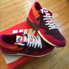 Nike Air Epic QS Brand new in box Nike Air Epic  retro style size 11mens. Great bright colors-- deep burgundy, electric orange and berry Nike Shoes Sneakers