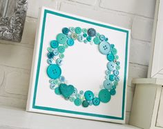 Aqua button wreath on a painted canvas. Cute way to showcase color collections or accent the seasons or room decor #stampinup