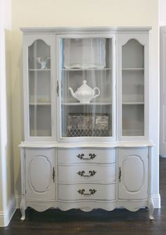 This French Provincial Hutch had beautiful lines- just needed a little updating! This light grey Annie Sloan paint was all it needed!
