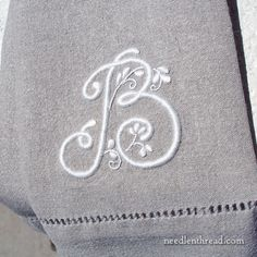 This is a group of articles that takes you step-by-step through embroidering a whitework monogram mostly in satin stitch.