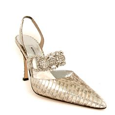 A sexy sling back that will leave all eyes on you! This snake sling back has been brushed with silver and gunmetal to give it a fine and sexy look. With a crystal piece overlaying in the front and a 4 inch covered heel.