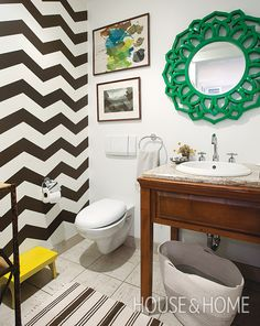 A chevron wall distracts the eye from the less stylish parts of the bathroom, and it was an easy DIY project. | Photographer:  Janis Nicolay  Designer:  Nancy Riesco