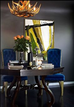 Pinner states: dark.  sexy.  Look at the gray walls - invite you to add a deep rich color and have fun with the room.