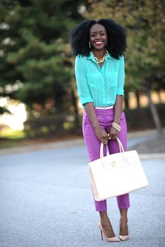 Nifesimi of Skinny Hipster wearing a bright turquoise blouse and purple gelato colored pants