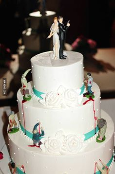 Zombie Wedding Cake! I really like how this is done, the cake is really beautiful but the zombie touches are really awesome. Good thing I already ordered our cake otherwise my Mom would be worried
