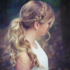Wavy low ponytail with braid headband and loose face framing pieces. Perfectly effortless!