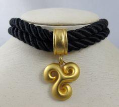 https://www.etsy.com/listing/218600031/vintage-escada-necklace-choker-black?ref=shop_home_feat_1