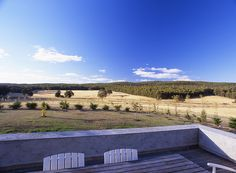 Wrap around exterior terrace overlooks rural site in Daylesford by B.E Architecture