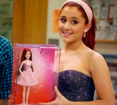 "Ariana Grande taking a picture with the new ""Cat"" doll from ""Victorius""."