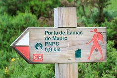 Hiking sign, Peneda-Gerês National Park, Portugal - The best way to explore Peneda-Gerês National Park is on foot. There are plenty of hiking trails in the different mountains of the Park, including some short ones for those visiting just for the day and multi-day treks.