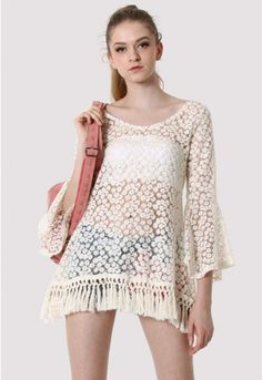 -This crochet top features daisy floral pattern with puff sleeves, fringe hemline design. Perfect to go with jeans and boots.-80%cotton 20%polyester-Machine wash Size(cm) Length Sleeves BustS/M 75 55 88 fits US0/6 UK6/10 EU34/40 Size(inch)Length Sleeves BustS/M 29.5 21.5 34.6 fits US0/6 UK6/10 EU34/40