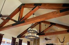 Timber Frame Trusses in Family Room at a Ranch Home Designed by Stephen Chambers Architects of Dallas, Texas. - See more at: http://chambersarchitects.com/montague-county-ranch.html#sthash.1HZ7a3Jp.dpuf And see all of our custom ranch homes at: http://chambersarchitects.com/ranches/custom-ranch-home.html