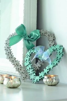 Have some old jigsaw puzzles lying around with missing pieces? Make something out of them for your home. These jigsaw hearts are simple to make and are quite pretty for a little girl's bedroom, too. www.essentials.co.za