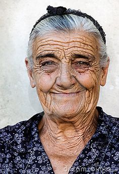 <><>The picture shows a happy old lady from a village in Greece © Akarelias | <><>