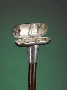 """Antique Walking Sticks, System Canes, Doctor's Bloodletting  Cane This fine doctor's cane was perfect for house calls. The silver T-shaped handle is actually a bloodletting case containing glass syringe components. The inside of the case is marked """"Arnold & Sons, London."""" Arnold & Sons was known as a maker of fine medical and surgical instruments whose devices are eagerly sought by collectors today. This is truly an exceptional and rare item. Circa 1890 35 1/2"""" length"""