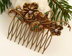 Antique hair comb in bronze with flowers and leafs by Schmucktruhe