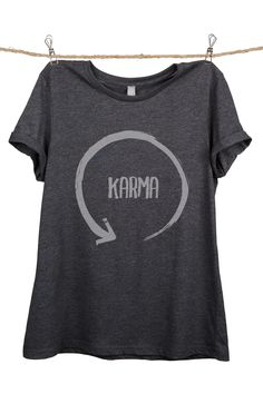 """""""Karma"""" is featured on a crew neck, short sleeves and a new modern, relaxed fit for effortless style. Printed on quality constructed tri-blend material, these shirts are perfect with a pair of jeans o"""