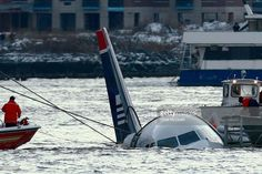 Rescue crews secure a US Airways flight 1549 floating in the water after it crashed into the Hudson River January 15, 2009 in New York City. The Airbus 320 craft crashed shortly after take-off from LaGuardia Airport heading to Charlotte, North Carolina.