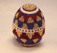 Hand beaded egg by Diane Kidman. One-of-a-kind design, each glass seed bead is placed by hand.